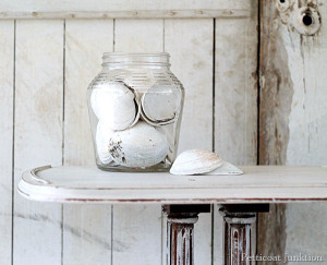 sea-shells-on-a-shabby-white-table-Petticoat-Junktion